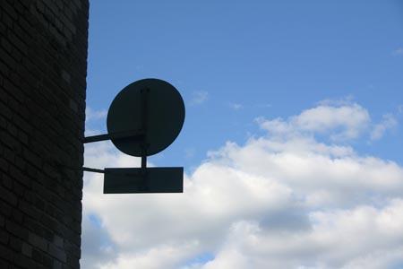 sign_bricks_sky
